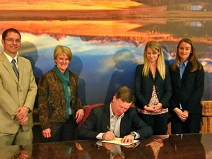 Gov. Hickenlooper signs Rep. McCann's bill that helps to fight human trafficking in Colorado.